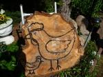 Vogel auf Holz gezeichnet